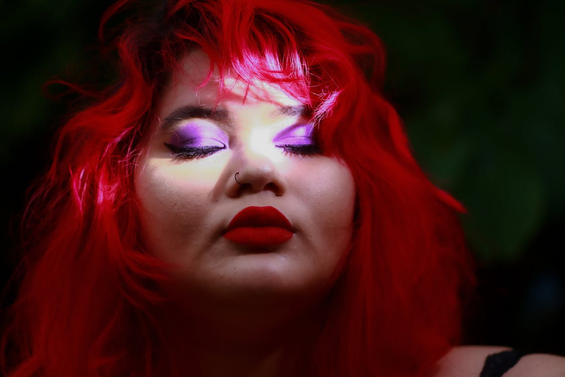 Red Haired Woman With Heavy Makeup