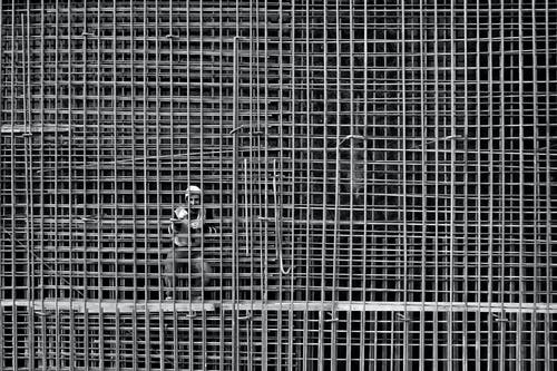 Man Working On Steel Bars Reinforcement In A Construction