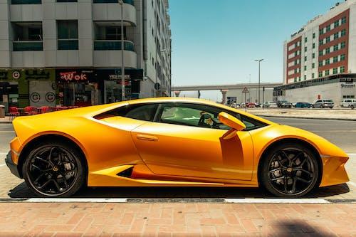 Photo Of Yellow Lamborghini Beside Road