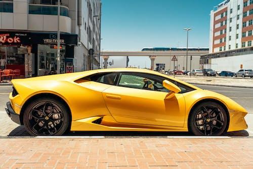 Photo Of Yellow Lamborghini Parked Beside Road