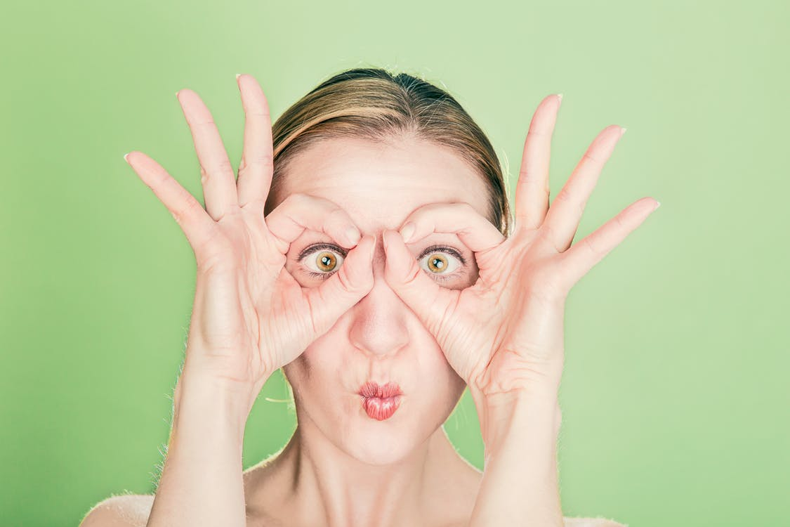 Woman Doing Goggles Hands Gesture