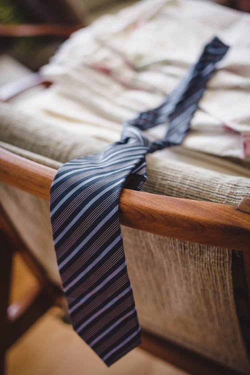 Striped blue tie placed on chair