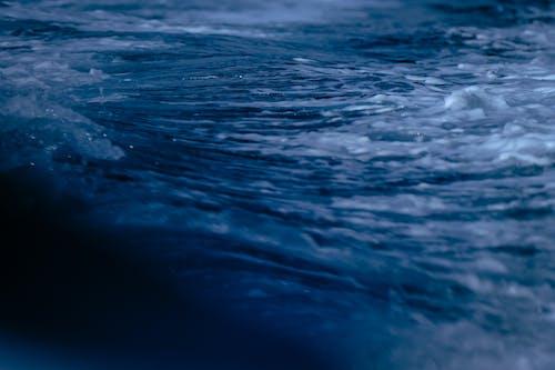 Foamy sea waves washing on coast
