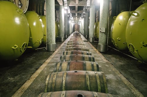 Yellow and Black Wooden Barrels