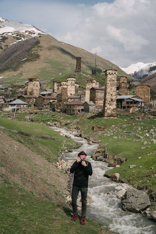 Man in Black Jacket Standing Near River