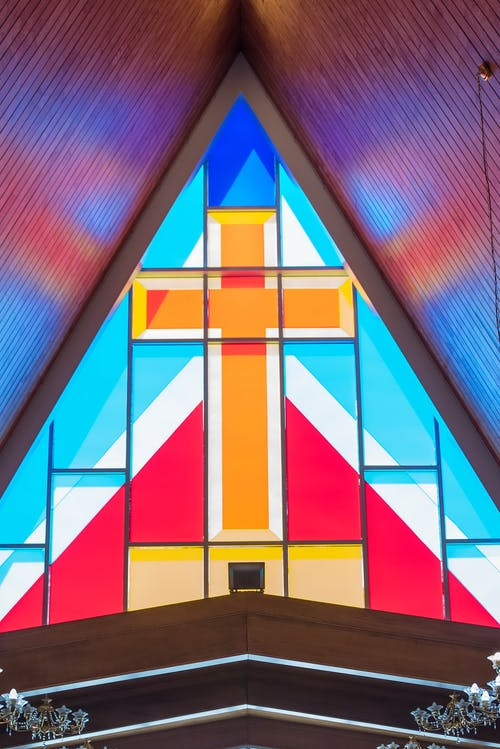 Colorful geometrical stained glass window with rood