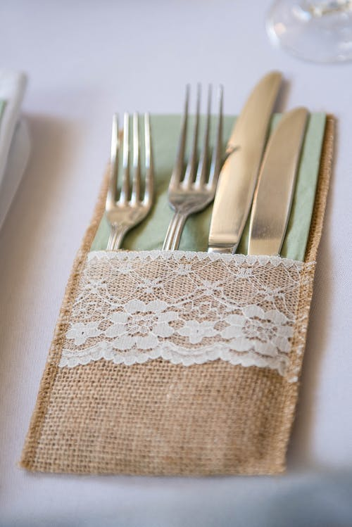 Silverware in elegant pouch placed on table
