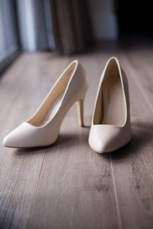 Pair of stylish wedding shoes on floor