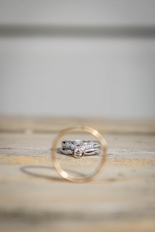 Silver and golden rings on table during festive event