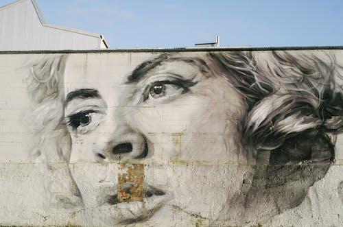 Woman's Face Graffiti on Wall