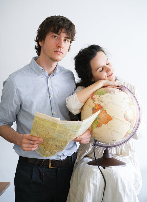A Couple Planning a Trip Around the Globe