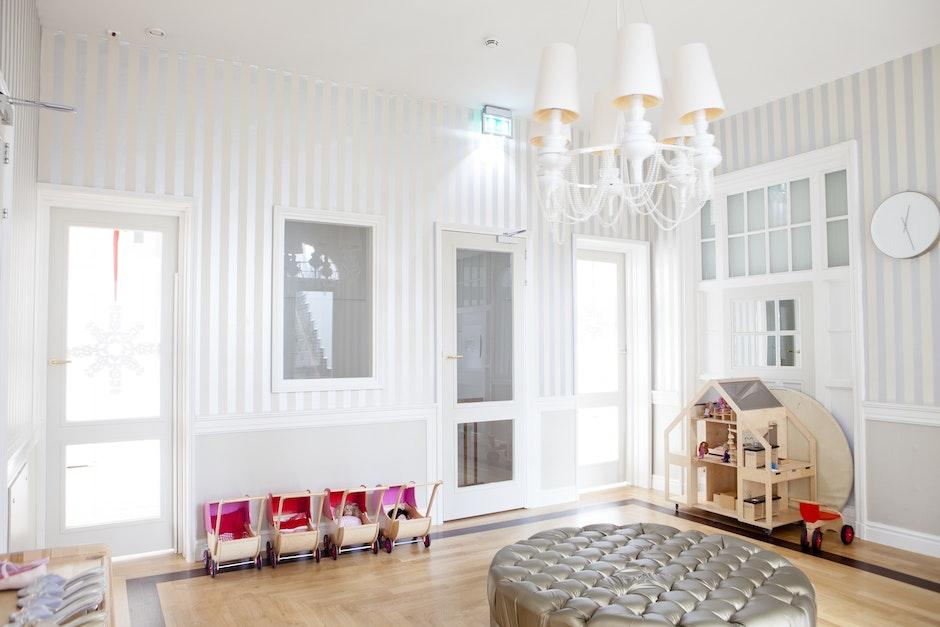 White Uplight Chandelier on White Room