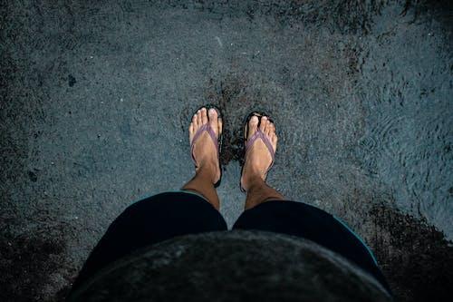 Person Wearing Flip-Flops