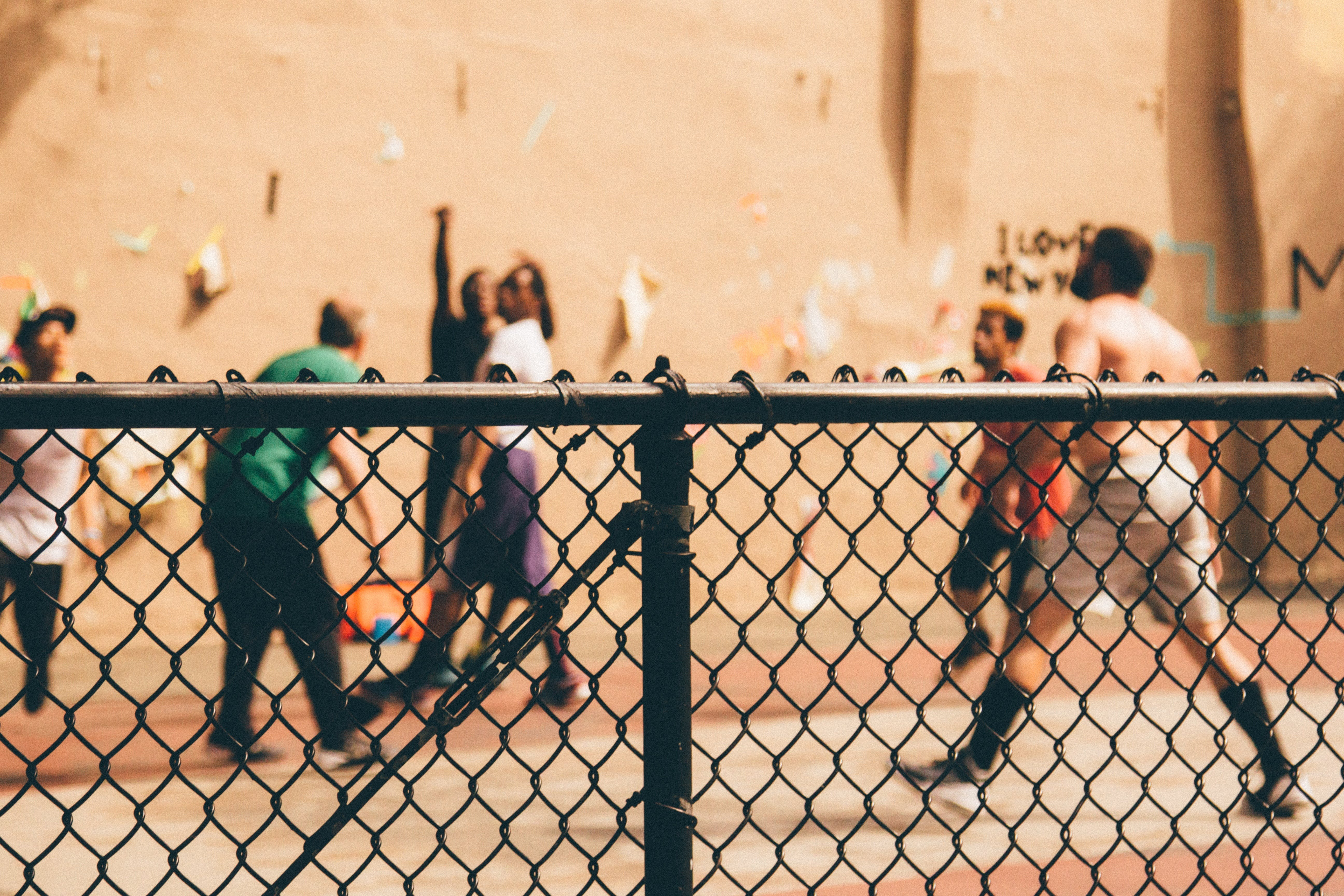 Topless Man Standing in Front of the Brown Wall