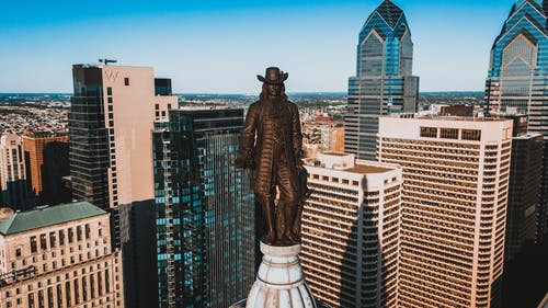 Drone view of monument of William Penn located on top of high tower in Philadelphia