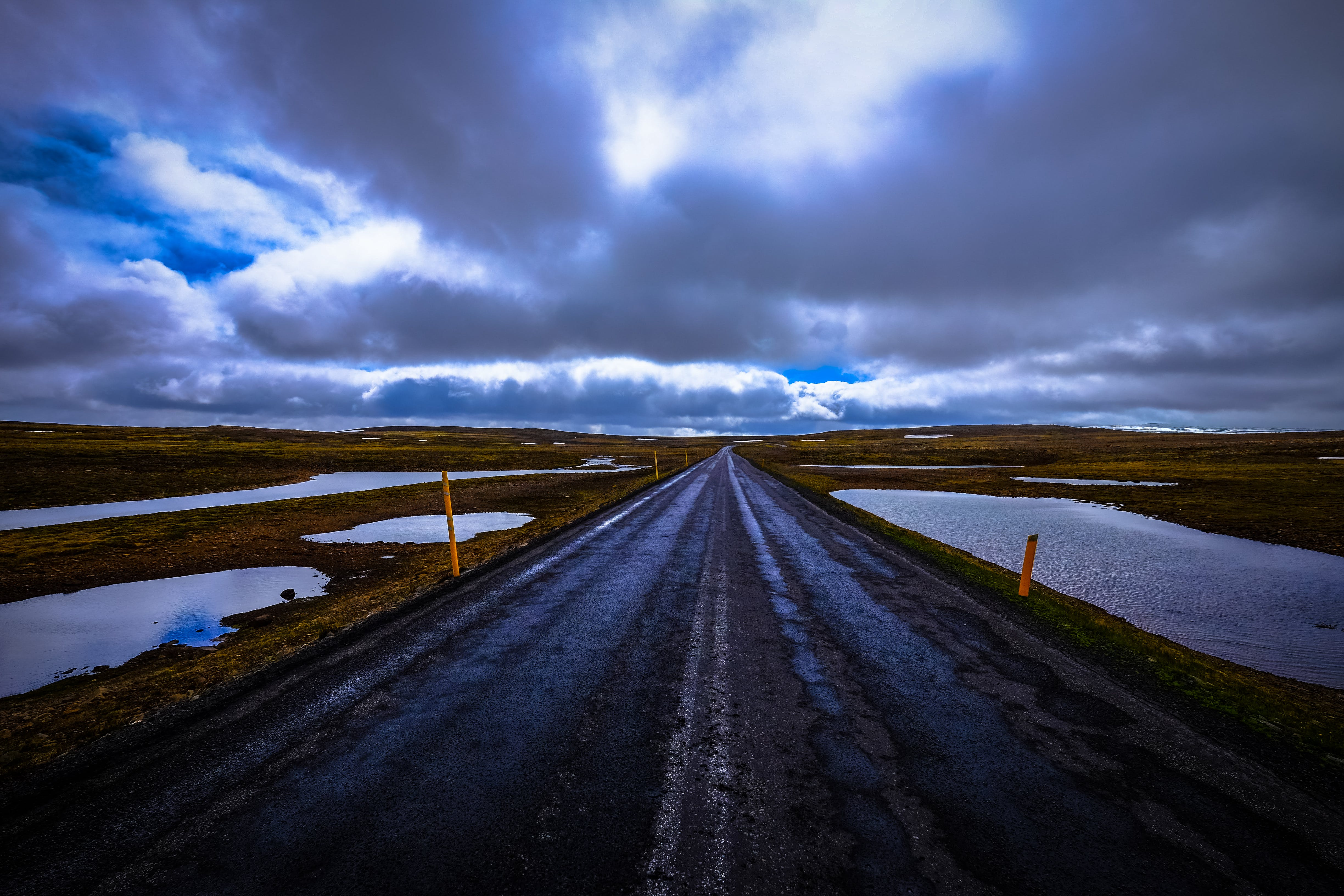 Road Surrounded With Body of Water