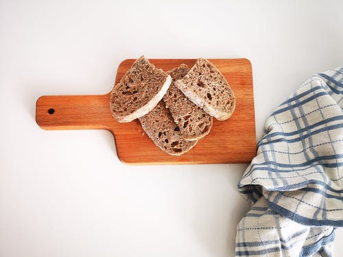 Brown Wooden Chopping Board on White Table