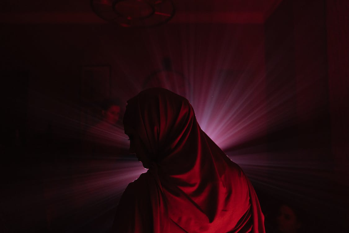Person in Red Hijab Standing