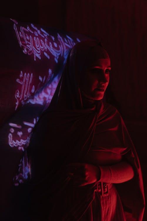 Woman in Black Hijab Sitting on the Floor