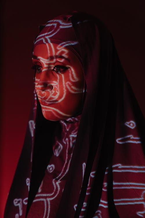 Woman in Red Hijab and Black Robe