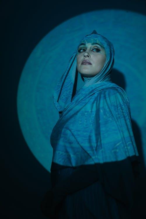 Woman in Teal Hijab and Black Dress