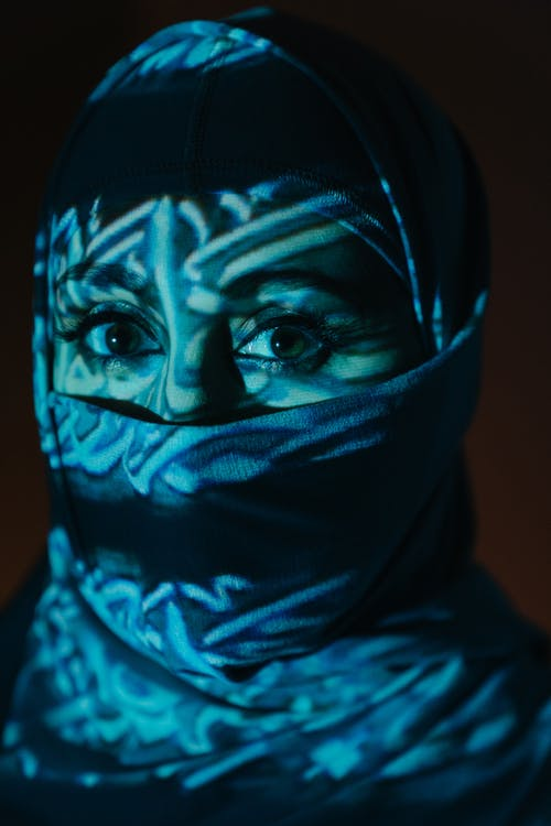 Person in Black Hijab and Teal Scarf
