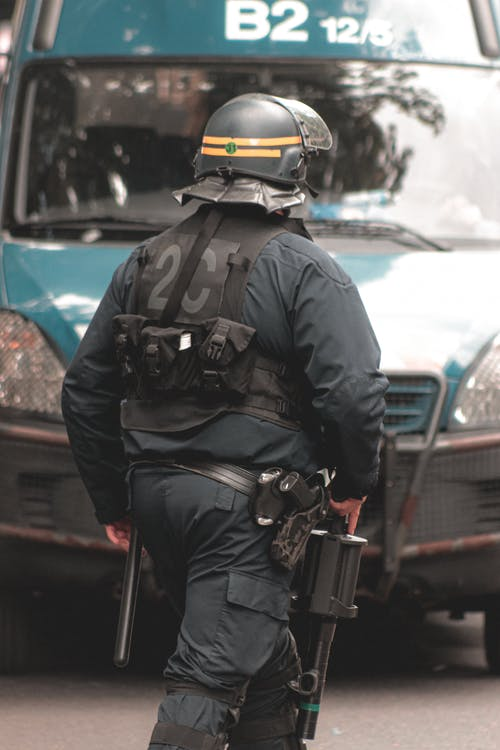 Police officer in helmet and protective vest