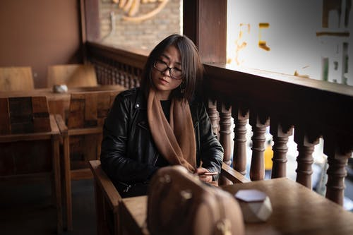 Focused Asian woman sitting in cafe