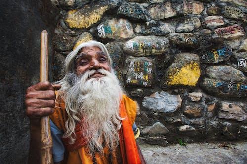 Elderly ethnic man with cane