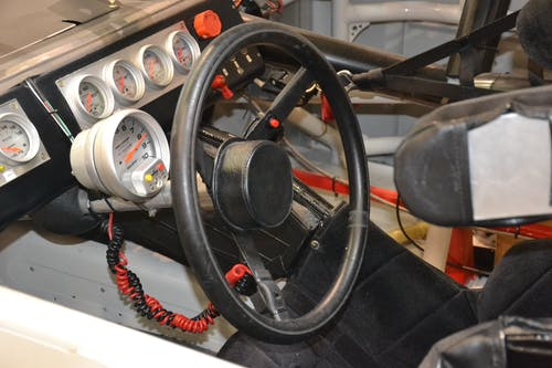 araba yarışı, direksiyon, yarış otomobili içeren Ücretsiz stok fotoğraf