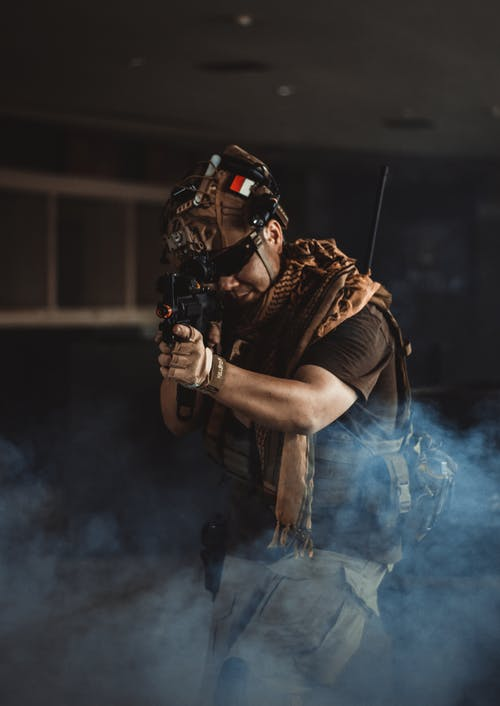 Man Holding Black Rifle