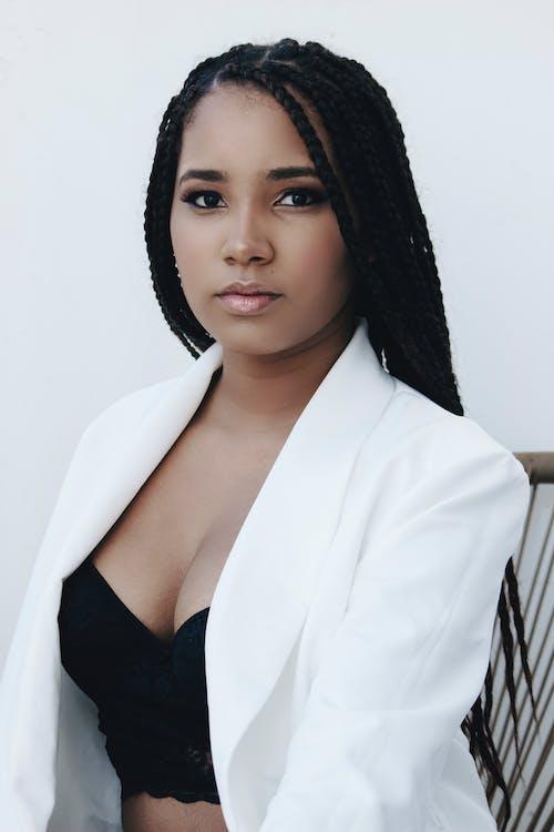 Woman in Black Brassiere and White Blazer