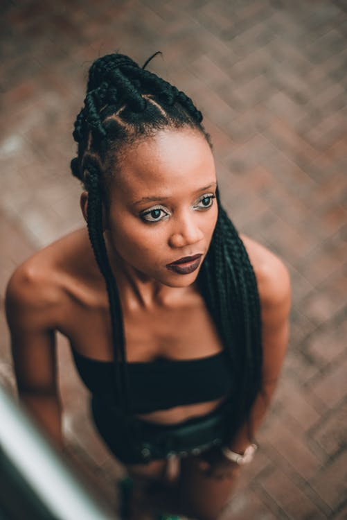 Selective Focus Photo of Woman With Braided Hair