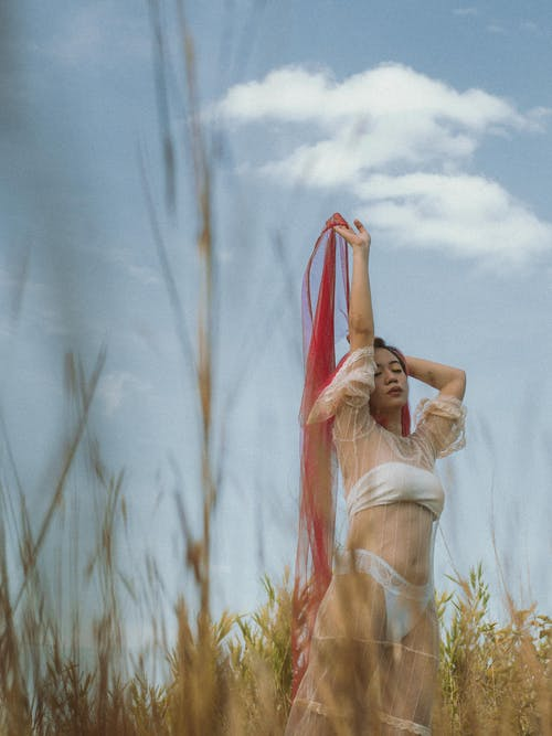 Woman in White Dress Standing on Wheat Field