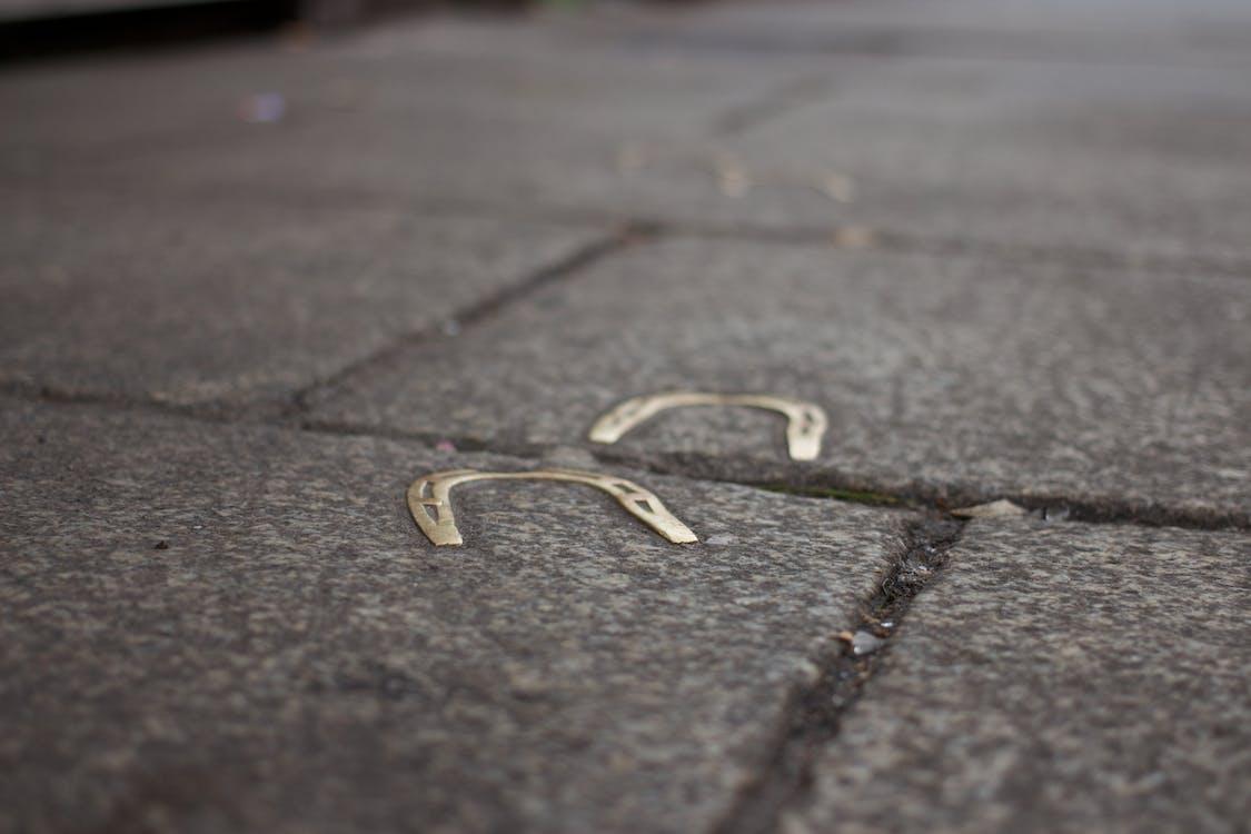 Horseshoe on Black Concrete Pavement