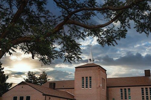 Overcast sky over small monastery near park