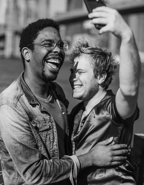 Grayscale Photo of Two Men Taking a Selfie