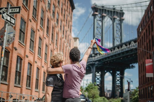 Couple Holding a LGBT Flag