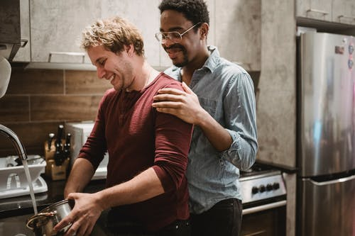 Two Men Smiling in the Kitchen