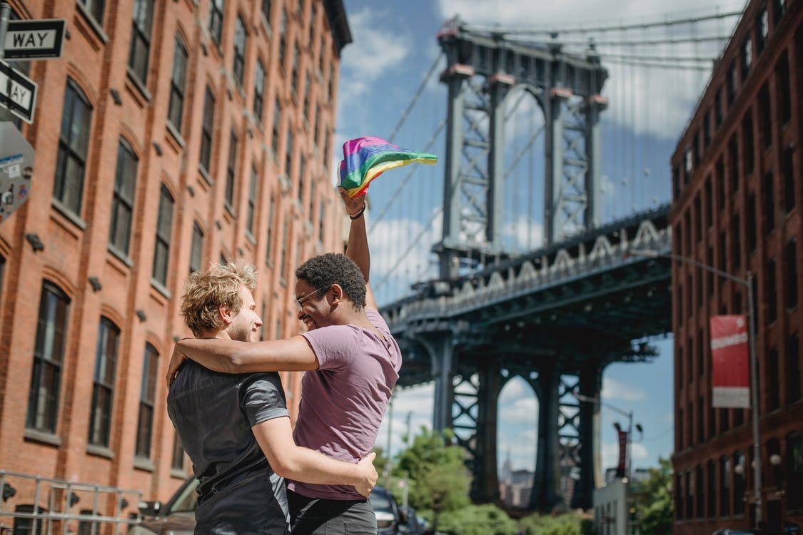 Happy Couple Holding a LGBT Flag