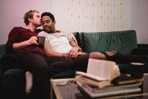 Two Men Cuddling on a Couch