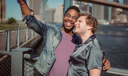 Two Men Smiling and Posing