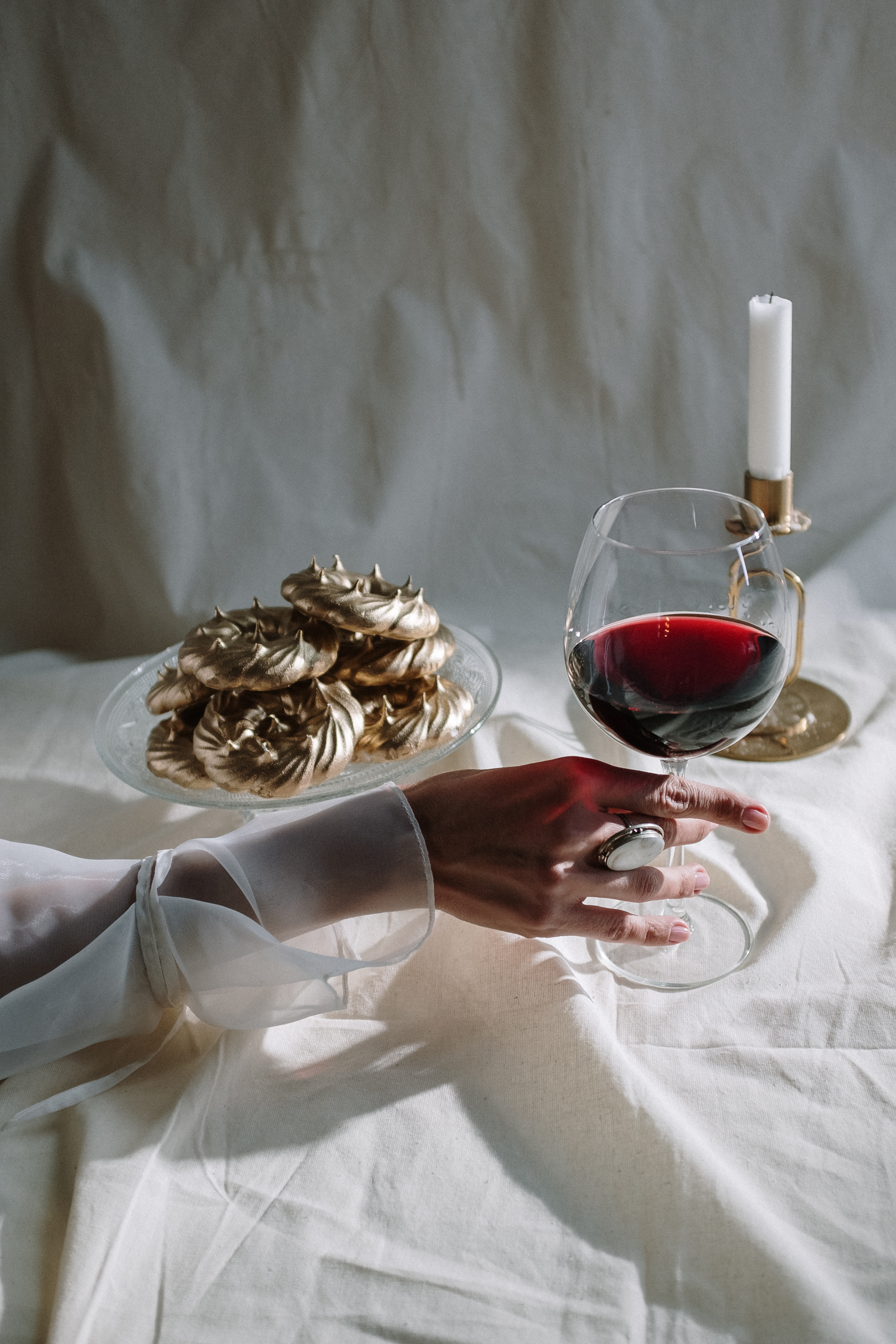 woman holding wine glass with red wine