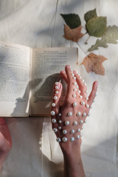 Person Holding White Book Page