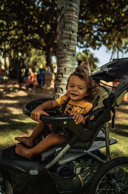 Boy Sitting in Baby Stroller
