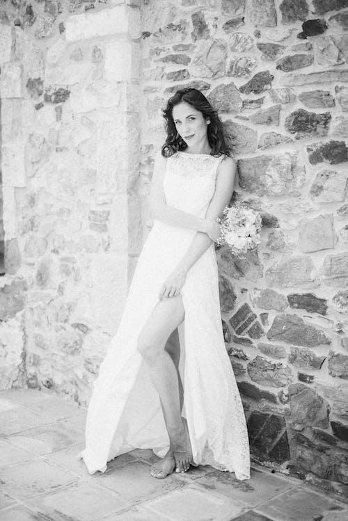Monochrome Photo of Woman Smiling While Wearing White Wedding Dress