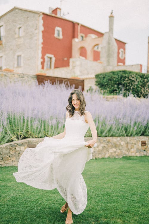 Photo of Woman in White Wedding Dress Smiling
