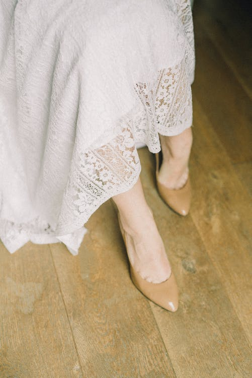 Person in White Lace Skirt