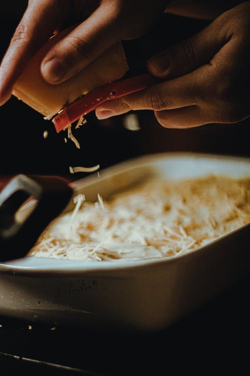 Photo of Person Grating Cheese