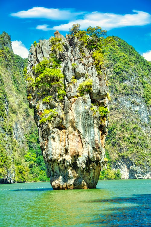 Gray Rock Formation Near Body of Water